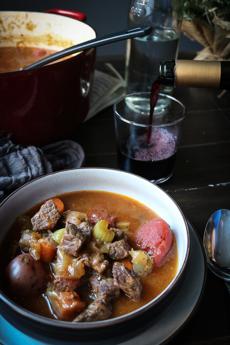Bowl of stew with red wine