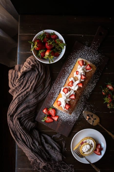 Filled with a Strawberry Cream, this Lemon Cake creates a masterpiece in your mouth.  Lemon Sponge Roll Cake with Strawberry Filling may just be the perfect dessert for your next ladies lunch.