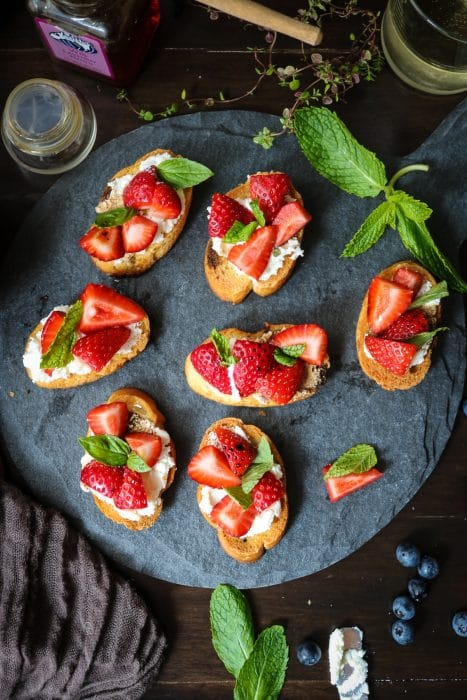 Topped with balsamic infused strawberries and ricotta cheese, this delightful appetizer or dessert is one of my favorite crostini recipes yet!
