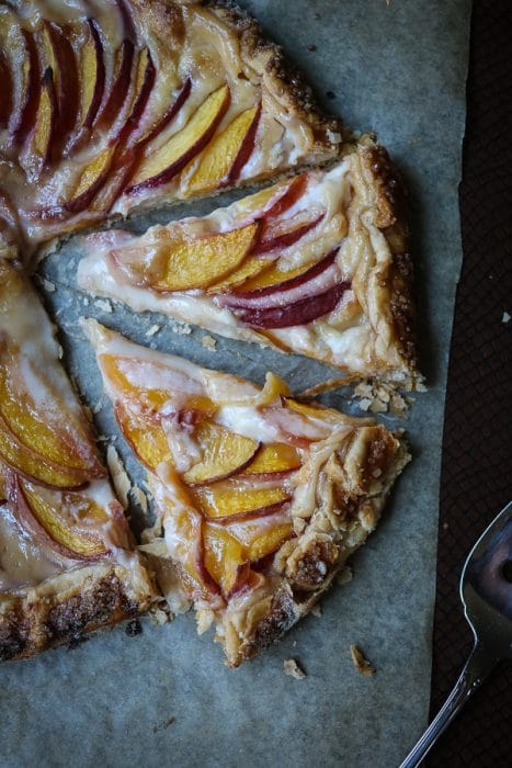 What happens when you combine the sweetness of summer peaches and the creaminess of a cream cheese icing and your favorite pie crust?  You get a beautiful crostata dessert!  Or this Peaches and Cream Crostata to be precise.