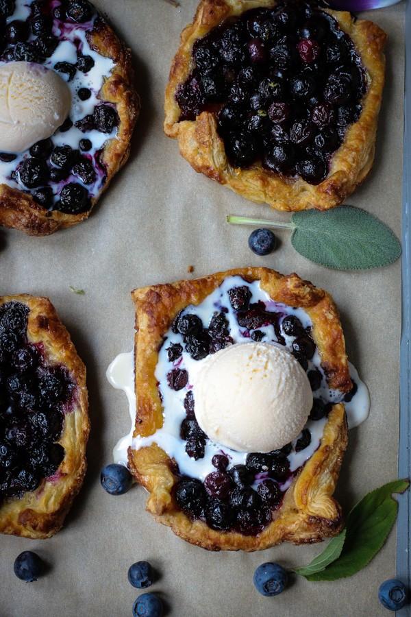Mini blueberry tart with vanilla ice cream.
