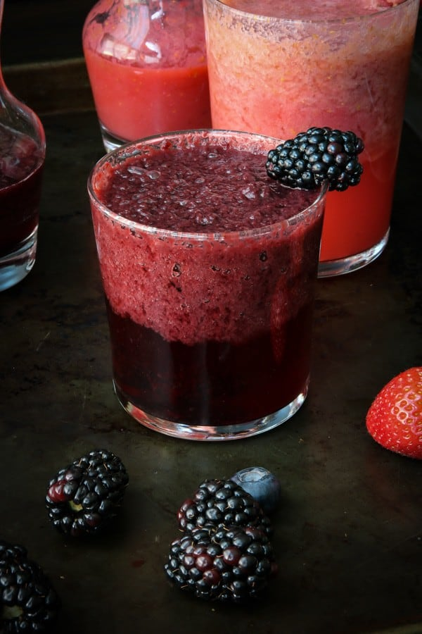 Blackberry Blueberry mimosa drink on tray